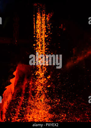 Metal on casting. Metallurgy.  High temperature in the melting furnace. Heavy forging steelmaking plant and steelmaking workshop. Oven. Water curtain. - Stock Photo