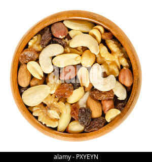 Student food in wooden bowl. Student fodder. Snack mix of dried almonds, cashews, peanuts, walnuts, hazelnuts and raisins. Trail mix. - Stock Photo