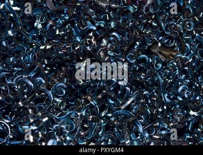 Scrap metal shavings swirls in blue tone - Stock Photo