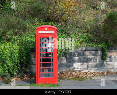 A single original old red telephone box. - Stock Photo