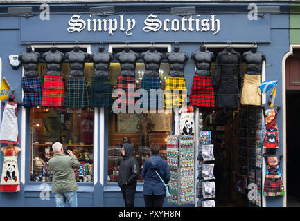 Row of male mannequins wearing kilts outside tourist gift shop on the Royal Mile in Edinburgh, Scotland, UK. - Stock Photo