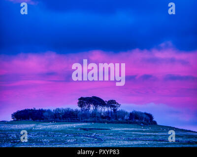Minning Low hill, Peak District, UK. 24th October, 2018. Weather UK: Sunset over Minning Low hill Historic England monument with a chambered tomb & two bowl barrows viewed from Harborough Rocks, Peak District, UK Credit: Doug Blane/Alamy Live News - Stock Photo