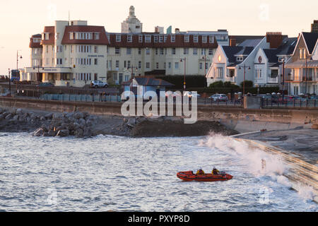 Porthcawl, South Wales, UK. 24th Oct, 2018. UK weather: The RNLI and HM Guardguard conduct practice rescue exercises off the coast this evening. Credit: Andrew Bartlett/Alamy Live News - Stock Photo