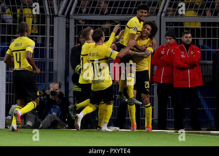 Dortmund, Germany. 24th Oct, 2018. Axel Witsel (1st R) of Borussia Dortmund celebrates after scoring during the Group A match of the UEFA Champions League between Borussia Dortmund and Club Atletico de Madrid in Dortmund, Germany, on Oct. 24, 2018. Dortmund won 4-0. Credit: Joachim Bywaletz/Xinhua/Alamy Live News - Stock Photo