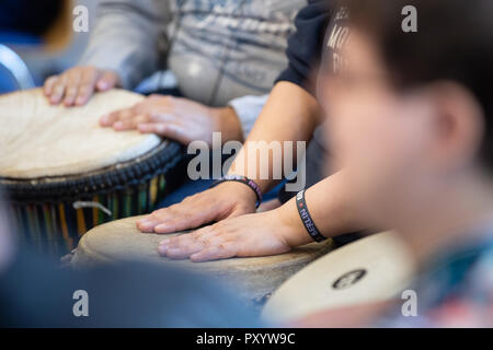 Berlin, Germany. 19th Oct, 2018. 19 October 2018, Germany, Berlin: The drum band of the Erfurt Disabled Workshop drums at the rehearsal with the orchestra of the Christian Youth Village Work of Germany (CJD) in the Berlin City Mission. After eight months of training, the band is allowed to perform in the Berliner Philharmonie. (to dpa 'Disabled drummers make it on big stage' from 25.10.2018) Credit: Fabian Sommer/dpa/Alamy Live News - Stock Photo