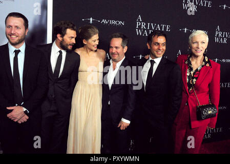 Beverly Hills, California, USA. 24th October, 2018. Director Matthew Heineman, actor Jamie Dornan, actress Rosamund Pike, actor Tom Hollander, writer Arash Amel and singer Annie Lennox attend the Los Angeles Premiere of Aviron Pictures' 'A Private War' at Samuel Goldwyn Theater in Beverly Hills, California. Photo by Barry King/Alamy Live News - Stock Photo