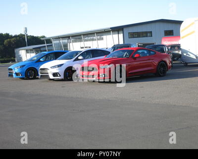 Ford Focus RS and mustang 5.0 shown at donnington park race circuit at the RS owners club national day - front and side view - Stock Photo