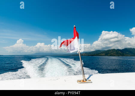 Wake of a speedboat on the ocean - island hopping at Bali, Indonesia - Stock Photo