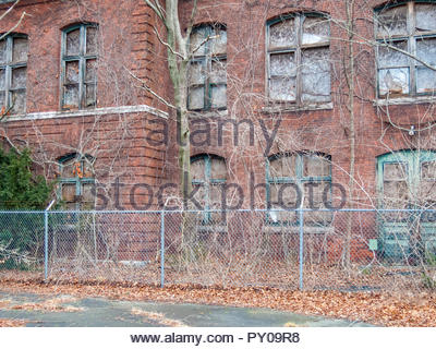 Old Atlas Tack factory now overgrown and dilapidated in Fairhaven, Massachusetts - Stock Photo