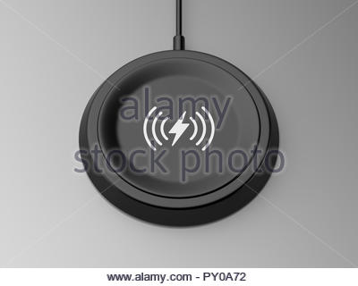 3d rendered angled view of a black wireless charger with a bevelled edge and recessed base on a grey background. - Stock Photo