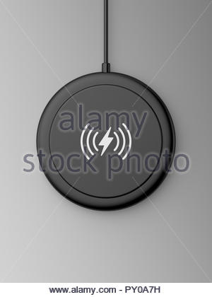 3d rendered top view of a black wireless charger with a rounded edge and flat base on a grey background. - Stock Photo