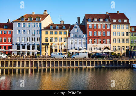 Copenhagen, Denmark - October 22, 2018: Front view of Nyhavn, the 17th-century famous waterfront, canal and entertainment district in the city center. - Stock Photo