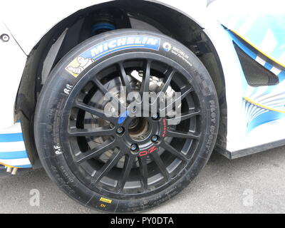 Ford fiesta RS WRC rally car shown at donnington park race circuit at the RS owners club national day in kroon oil livery after the ADAC rallye germany Deutschland 2018 close up of alloy wheel and competition racing brakes and suspension - Stock Photo