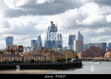 The City of London skyline viewed from east London docklands and across the River Thames England UK - Stock Photo