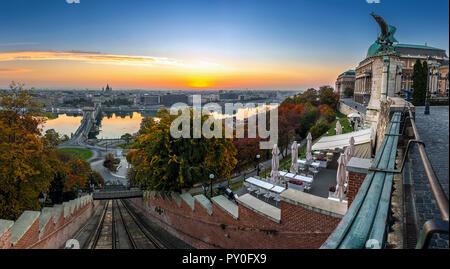 Budapest, Hungary - Budapest Castle Hill Funicular (Budavari Siklo) track and Buda Castle Royal Palace at sunrise. Szechenyi Chain Bridge, River Danub - Stock Photo