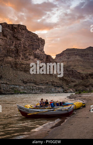 Inflatable rafts at scenic sunset, Desolation/Gray Canyon section, Utah, USA - Stock Photo