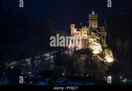 Bran Castle, Romania. Stunning night image of Dracula fortress in Transylvania, medieval landmark. - Stock Photo