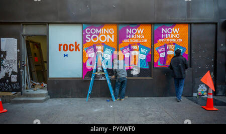 Signage on the exterior of a future Taco Bell Cantina in Chelsea in New York announces that the restaurant franchise is hiring, seen on Tuesday, October 23, 2018. Taco Bell is opening smaller format Cantina and Urban In-Line restaurants throughout New York City with amenities such as wi-fi and local artwork with the Cantinas serving alcohol. (© Richard B. Levine) - Stock Photo