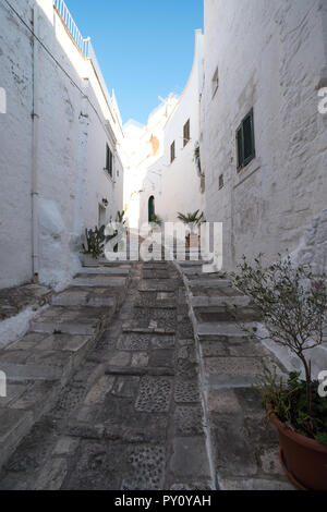 Ostuni Italy. White washed buildings on a stepped street in Ostuni in Puglia, Southern Italy.