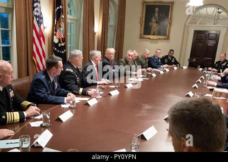 U.S President Donald Trump meets with senior military commanders in the Cabinet Room of the White House October 23, 2018 in Washington, DC. - Stock Photo