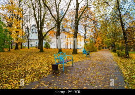 Autumn in Veliky Novgorod, Russia. Alley at Yaroslav courtyard and ancient churches on the background in Veliky Novgorod, Russia, October view - Stock Photo