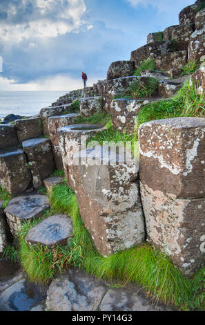 Tourist on the Giant's Causeway in County Antrim, Northern Ireland - Stock Photo