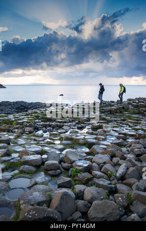 Tourists on the Giant's Causeway in County Antrim, Northern Ireland - Stock Photo