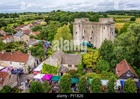 aerial view of Nunney Castle and Nunney Fayre in Nunney, Somerset, UK on 1 August 2015 - Stock Photo