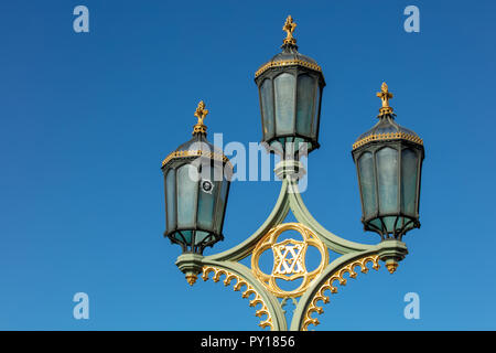 Vintage lamp post on Westminster bridge, London, UK, with modern LED fitting inside, producing an energy efficient and strong light for all its users. - Stock Photo