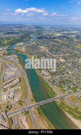 Aerial view of Calgary's bow river east of downtown looking towards the mountains. - Stock Photo