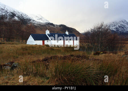 Blackrock Cottage at base of Grampian Mountains in autumn, Glen Coe, Lochaber, Scotland - Stock Photo