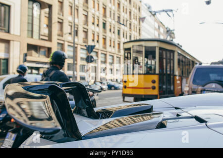 Yellow Tram on the streets of Milan Milano Italy - Stock Photo