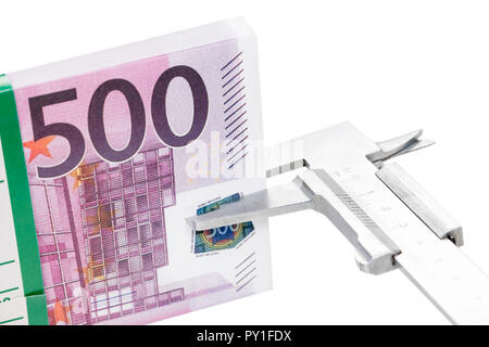 caliper measures money - Stock Photo