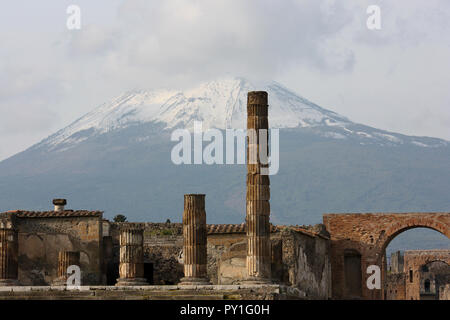 The ancient Roman town-city Pompeii destroyed and buried under volcanic ash and snowy Vesuvius - Stock Photo