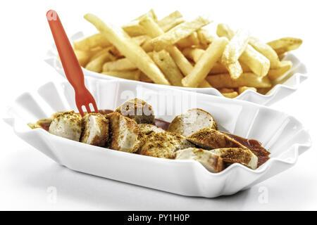 Currywurst und Pommes in zwei Schaelchen - Stock Photo