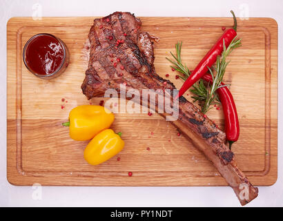 The Barbecue Tomahawk Steak on Cutting Board - Stock Photo