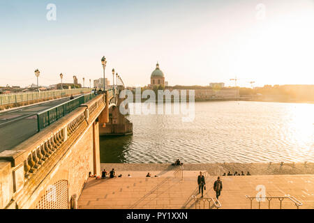Saint-Pierre bridge with Chapelle Saint-Joseph de la Grave on the background before sunset, Toulouse, Occitanie, France - Stock Photo