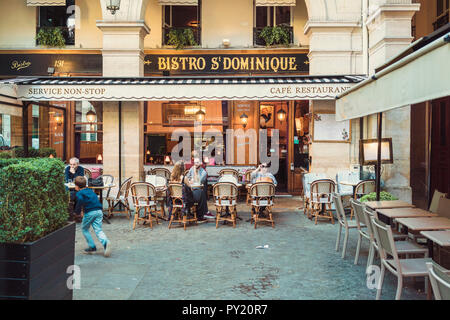 Front view of cafe at University street in Paris, Ile-de-France, France - Stock Photo