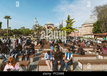 Hagia Sophia and people sitting in formal garden in foreground, Istanbul, Turkey - Stock Photo