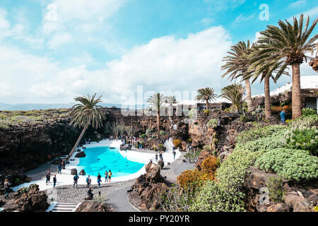 Landscape with rocky mountains and pool with turquoise water at Jameos del Agua, Lanzarote, Spain - Stock Photo
