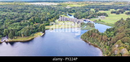 An aerial view of Lough Corrib, in County Galway, Ireland, with Ashford Castle in the background. - Stock Photo