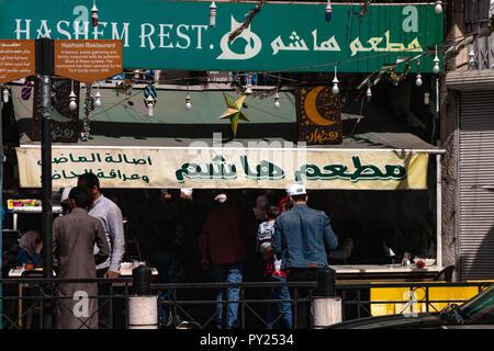 Amman, Jordan - October 16, 2018: View of cars and shops in the old town of Amman, Jordan. - Stock Photo