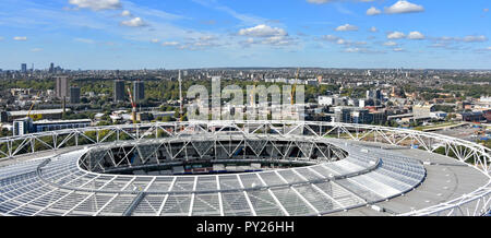 Aerial view of modified rooftop of Olympic stadium now London stadium rented by West Ham United as football stadium North London cityscape beyond UK - Stock Photo