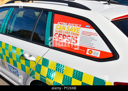 Healthcare awareness poster advert promotion  saving lives from Sepsis  NHS doctors car window in National Health service hospital Essex England UK - Stock Photo