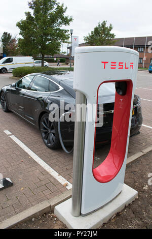Motorway service station charging for Tesla electric cars - Stock Photo