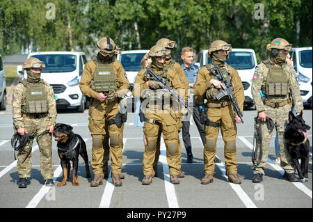 Soldiers of KORD (police strike force, SWAT), full armor, standing in a line on a ground. September 5, 2018. Kiev, Ukraine - Stock Photo