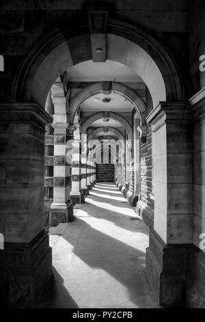 Archway in Dunedin, New Zealand that shows light and dark shadows, leading lines, with a hook in the centre of the image to rest your eye, fine art - Stock Photo