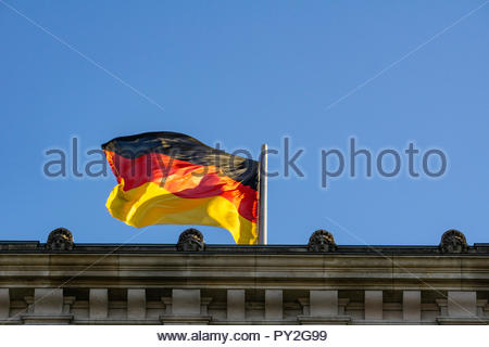 Close-Up of German National Flag on Top of the Reichstag  Building, Berlin, Germany - Stock Photo