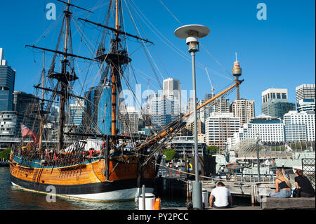 07.05.2018, Sydney, New South Wales, Australia - A sailing vessel is seen in Darling Harbour with Sydney's cityscape of the Central Business District  - Stock Photo