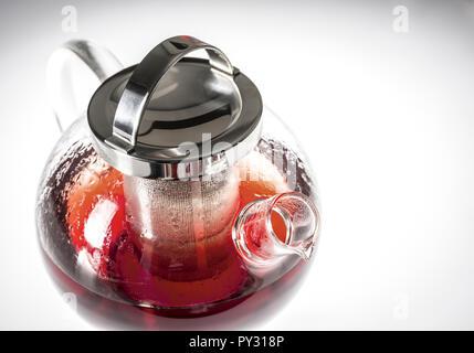Teekanne aus Glas mit Fruechtetee - Stock Photo